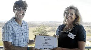 Neville Dywer receiving the High achiever award from ECA Riverina Rep, Julia Ham last year.